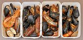 pic of crustaceans  - Sea shells and crustacean cooked and served in white plastic containers - JPG