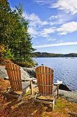 Adirondack chairs at shore of  Lake of Two Rivers, Ontario, Canada