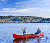 Father and daughter canoeing on Lake of Two Rivers, Ontario, Canada
