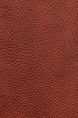 Brown natural leather background or texture close up
