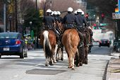 Atlanta Police Ride Horses Down Street Before St. Patrick's Parade