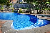 picture of paving stone  - Residential inground swimming pool in backyard with waterfall and hot tub - JPG