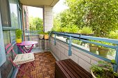 pic of planters  - Balcony of condo with patio furniture and plants - JPG