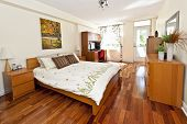Bedroom interior with hardwood floor - artwork is from photographer portfolio