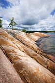 Smooth rocky lake shore of Georgian Bay in Killbear provincial park near Parry Sound, Ontario, Canad