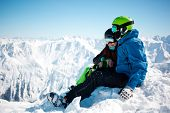 Young happy couple in snowy mountains. Winter sport vacation