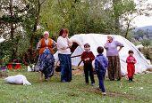 PAGARUSHA, KOSOVO, YUGOSLAVIA, 10 OCTOBER 1998 - unidentified Refugee families share a makeshift kit