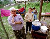 PAGARUSHA, KOSOVO, YUGOSLAVIA, 10 OCTOBER 1998 - unidentified Refugee families share a makeshift kitchen in a farm field in south-central Kosovo. Serbian forces continue to attack Kosovo, despite NATO air-strikes