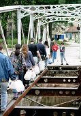 SARAJEVO, BOSNIA - SEP 15: Sarajevans cross a destroyed bridge in the besieged capital of Bosnia on their way to find water in Sarajevo, Bosnia, on Sunday, SEPT 15, 1993.