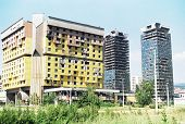 SARAJEVO, BOSNIA - JUNE 12: An exterior view of the Holiday Inn hotel and the UNIS towers in Sarajevo, Bosnia, on Saturday, June 12, 1993. The hotel houses the foreign press corps, and is frequently targeted by gunfire.