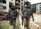 SARAJEVO, BOSINA - MARCH 18: Italian army troops, in Bosnia as part of the United Nations' UNPROFOR, patrol the streets on March 18, 1996 in Sarajevo, Bosnia.
