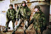 TUZLA, BOSINA - JAN 26: United States Army troops, in Bosnia as part of NATO's IFOR,  protect a fron