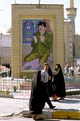 BAGHDAD, IRAQ - MARCH 11: Iraqis pass by a mosaic of Iraqi president Saddam Hussein praying. Saddam has in the past few months commissioned hundreds of new monuments to himself on March 11, 1999 in Baghdad, Iraq.