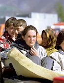 KUKES, ALBANIA - APRIL 17: An ethnic Albanian Kosovar family arrives at a refugee camp along the Kosovo border. The family had been driven from their home in Western Kosovo by Serbian forces on April 17, 1999 in Kukes, Albania