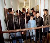 GYOR, HUNGARY - OCTOBER 14: Kosovar Albanian refugees crowd a Hungarian border police detention center west of Budapest.  Adnon Berisha, age 12, right, said he wants to join his family in Germany on October 14, 1998 in Gyor, Hungary