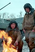 GUDERMES, CHECHNYA - JANUARY 16: Russian army armor troops try to keep warm, and catch a few minutes