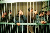 MOSCOW - SEPTEMBER 20: Moscow police process 50 Caucasian man and women, arrested earlier as part of a sweep to catch those responsible for a string of deadly bombings which killed 300 Russians on September 20, 1999 in Moscow