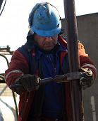 BAKU - AZERBAIJAN - FEB. 4: A roughneck maintains a drilling rig at a producing oil field near Baku,
