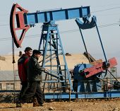 BAKU - AZERBAIJAN - FEB. 4: A roughneck maintains a drilling rig at a producing oil field near Baku, Azerbaijan, on Wednesday, February 4, 2009.