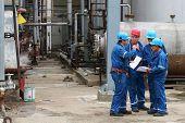 BUCHAREST, ROMANIA - NOV 9: Oil workers perform maintenance duties at the Arpechim refinery near Pitesti; on Nov 9, 2007 some 120 kilometers from Bucharest, Romania.