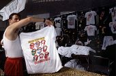 WASHINGTON, D.C. - AUG 4: A merchant prepares to sell tour T-shirts during the Rolling Stones' Steel