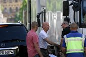 BUDAPEST - MAY 11: Sporting a freshly shaved head, actor Bruce Willis arrives on the set of Die Hard