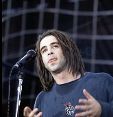 WASHINGTON, D.C. - AUGUST 4, 1994: Counting Crows lead singer Adam Duritz in concert at RFK stadium