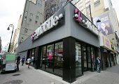 NEW YORK CITY - APRIL 19: Pedestrians walk past a retail outlet for T-Mobile in New York City, on Fr