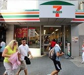 NEW YORK CITY - JULY 8: Pedestrians walk past a 7-Eleven convenience store in New York City, New Yor