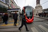 ISTANBUL, TURKEY - SATURDAY, MARCH 8, 2014: Commuters at a tram station in Istanbul, Turkey, on Saturday, March 8, 2014.