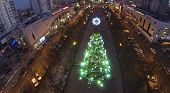 MOSCOW, RUSSIA - DEC 27, 2013: (aerial view) Christmas tree on street in Sokolniki. In central squar