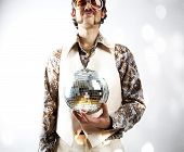 Instagram style portrait of a retro man in a 1970s leisure suit and sunglasses holding a disco ball