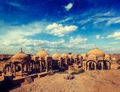 Vintage retro hipster style travel image of Bada Bagh cenotaphs ruins, Jodhpur, Rajasthan, India with grunge texture overlaid
