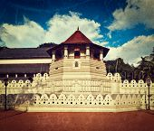 Vintage retro hipster style travel image of very important Buddhist shrine - Temple of the Tooth wit