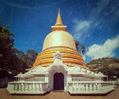 Vintage retro hipster style travel image of buddhist dagoba (stupa) close up  with grunge texture ov