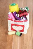 image of lurex  - Colorful bobbins of thread  in bag - JPG