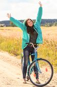 Cheerful brunette girl during cycling