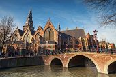 Amsterdam, Netherlands - March 19, 2014: Oude Kerk. Old Church On The Canal Coast In Amsterdam. Ordi
