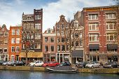 Amsterdam, Netherlands - March 19, 2014: Colorful Living Houses Along The Canal Embankment In Spring