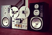 Analog Stereo Open Reel Tape Deck Recorder Vintage with Speakers Closeup
