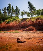 Red beach and cliffs of Prince Edward Island Atlantic coast near Cavendish, PEI, Canada.