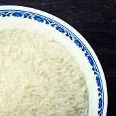 Blue Bowl Of Uncooked White Rice