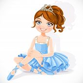Ballerina girl in blue dress sit on floor