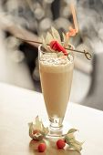 Milk cocktail decorated with physalis