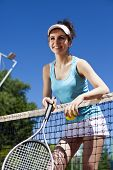 Young woman tennis player on the court