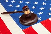 Wooden Judge Gavel And Soundboard Laying Over Us Flag - Closeup Shot