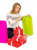 Young girl with bags and gift boxes isolated