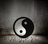 Conceptual image with yin yang sign and silhouettes of businesspeople around