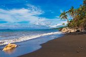 Beautiful Tropical Beach With Black Sand. Summer Vacation Concept.