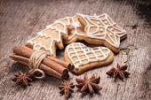 Christmas Gingerbread Cookies With Various Spices On Wood Background.